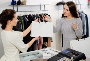 Girl sales personnel providing good service to a customer