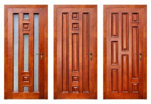 Three wooden door with intricate carving designs
