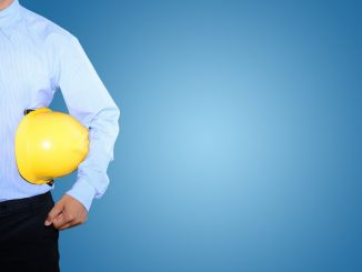 Man Carrying A Safety Helmet