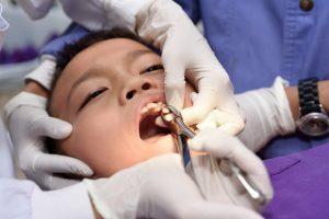 Young man undergoing dental procedures
