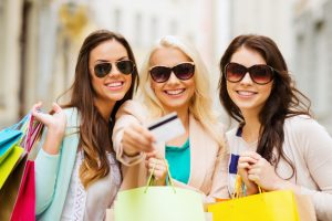 teens flaunting a credit card after going into a shopping spree