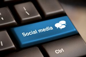 ocial Media button on a keyboard with speech bubbles.