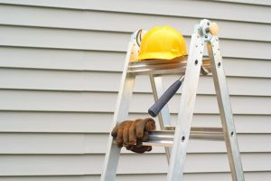 A house's siding being repaired