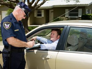 Police officer writing a traffic citation