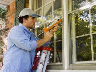 Man Air-Sealing the Home