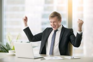 businessman happy about results of his risk