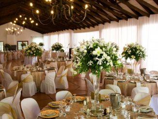 Wedding venue with bouquet as centerpieces