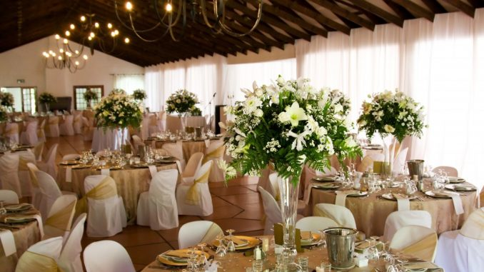 Wedding venue with bouquet as centerpieces