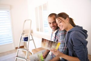 Couple choosing wall color for room renovation