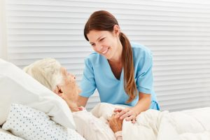 a nurse taking care of a senior