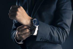 Man in suit wearing watch