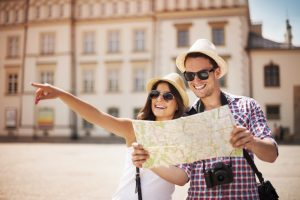 tourists sightseeing city with map