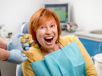 Woman smiling with new dental implants