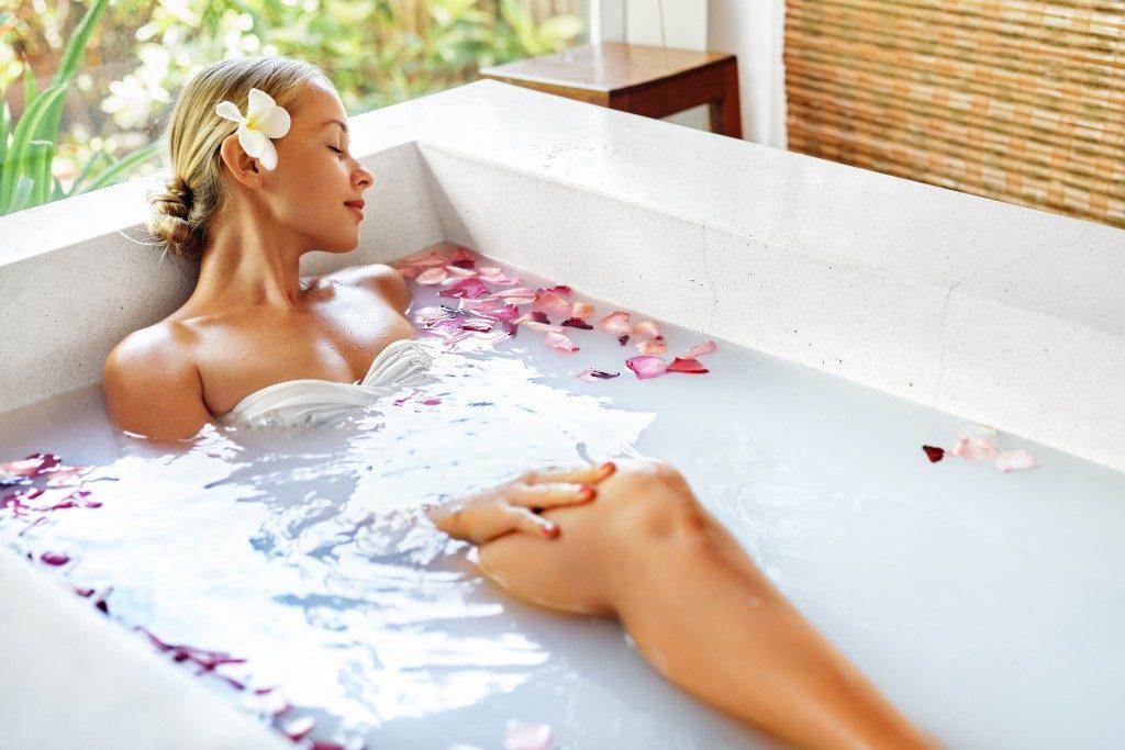 woma having herbal bath