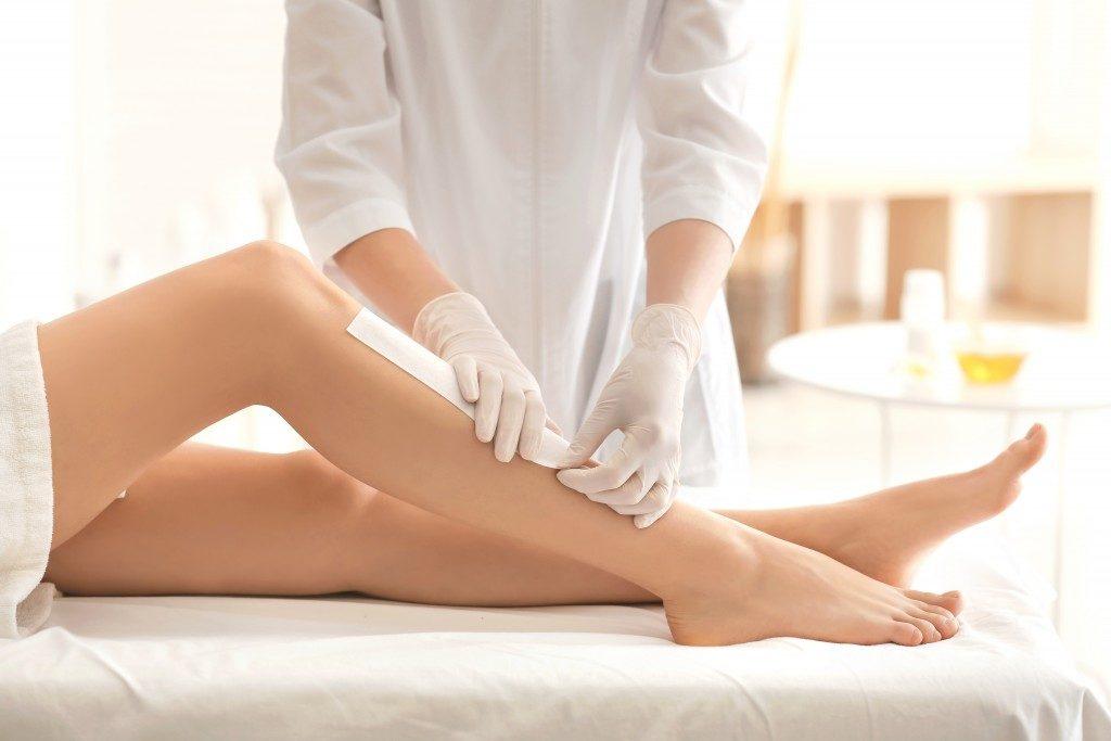 woman getting waxed