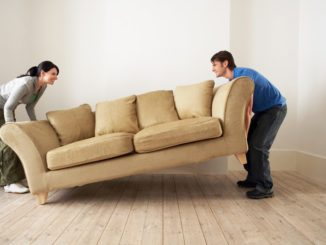 couple lifting couch