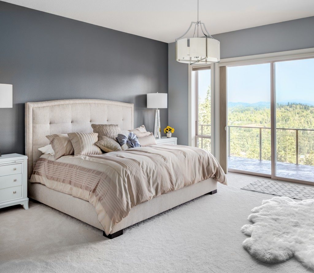 Luxury master bedroom with white carpet