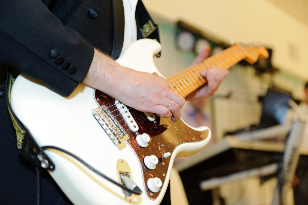 musician playing guitar on wedding party