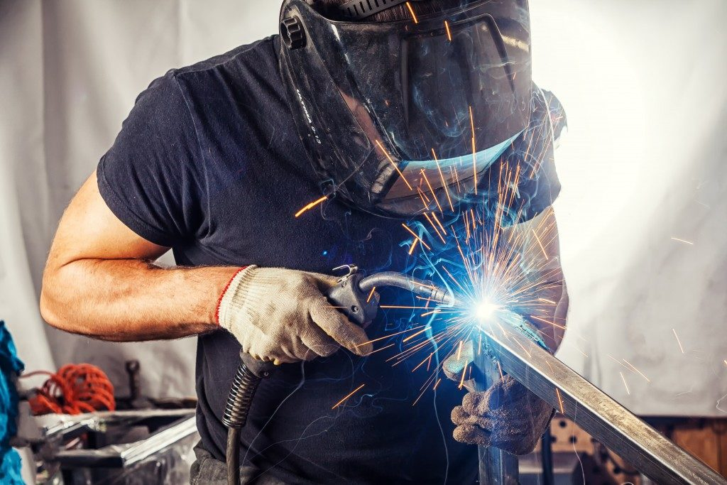 Man welding a metal
