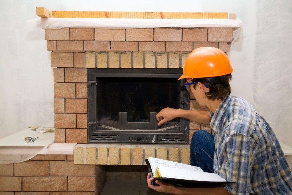 Man repairing chimney