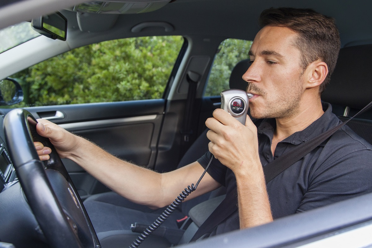 man driving testing for alcohol intoxication