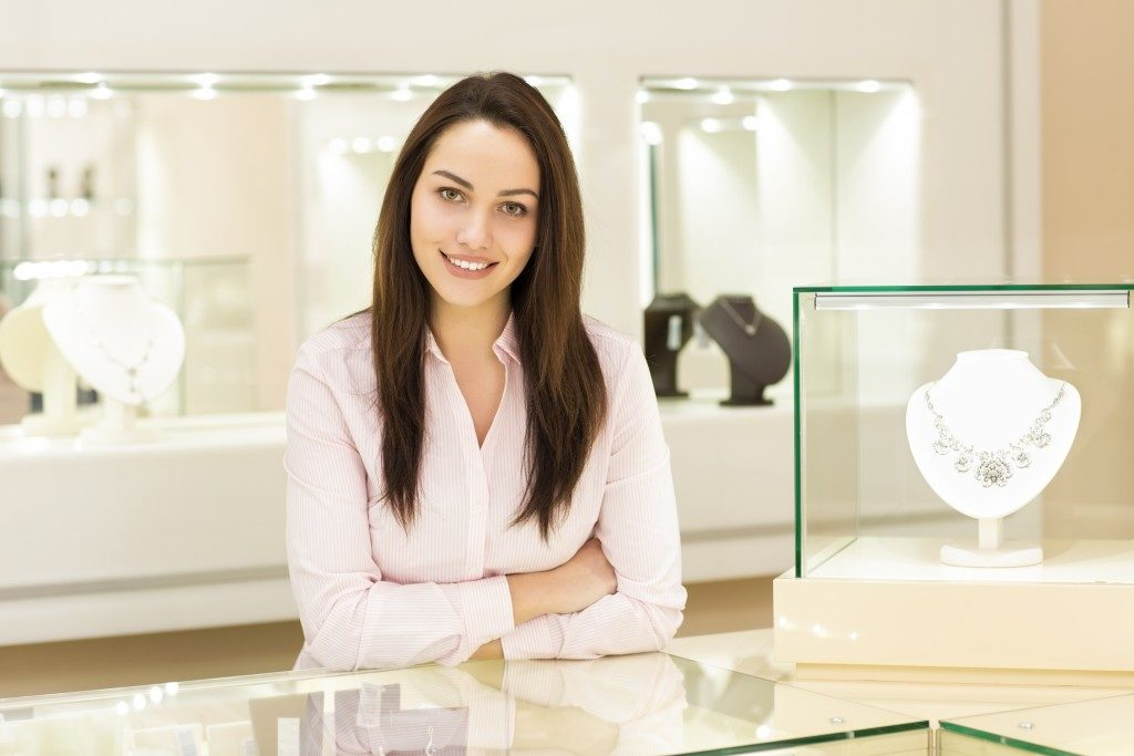an entrepreneur inside her jewelry shop