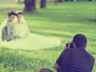 a wedding photographer taking shots of a married couple