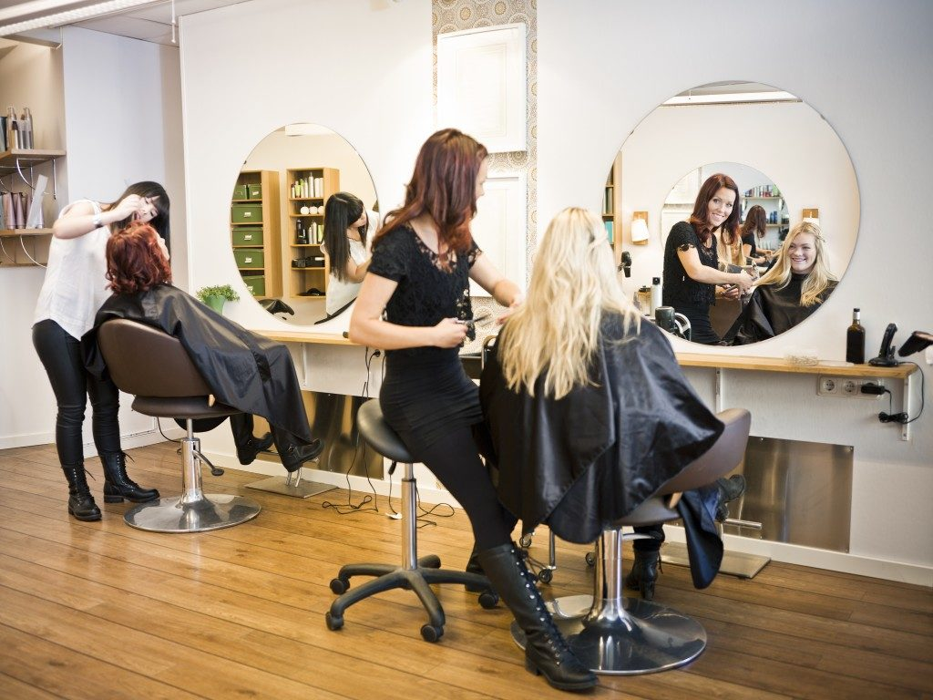 hairdressers serving their customers