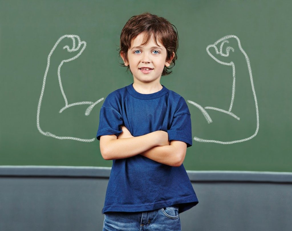 Strong child with muscles
