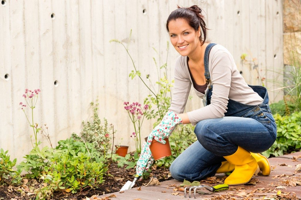 woman cultivating her plants
