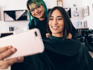 girl taking a selfie with her hairdresser