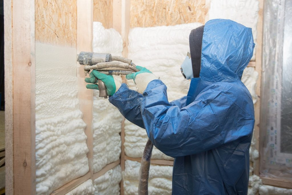 Man insulating a home