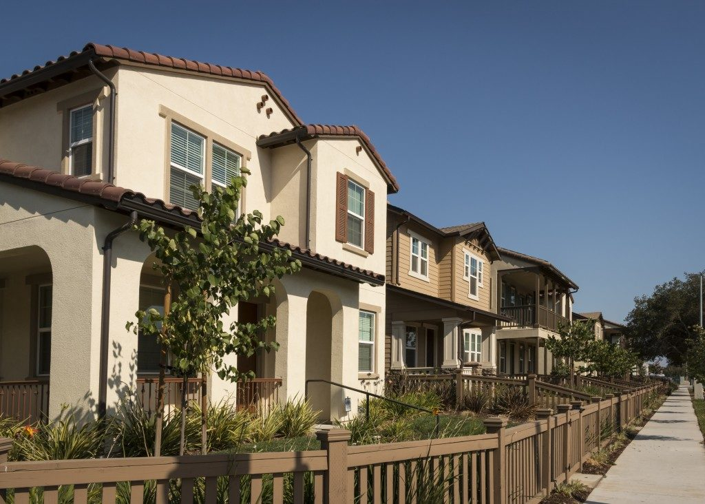 row of homes with fenced yards