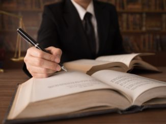 lawyer writing on the book
