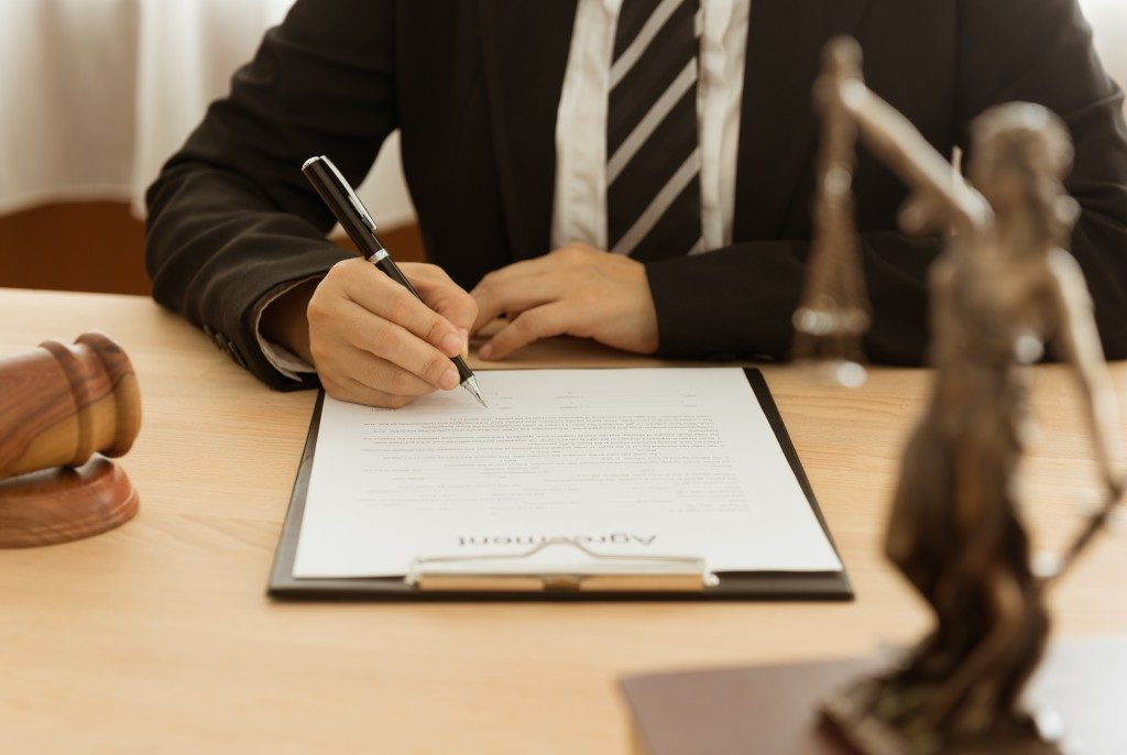 lawyer signing a contract