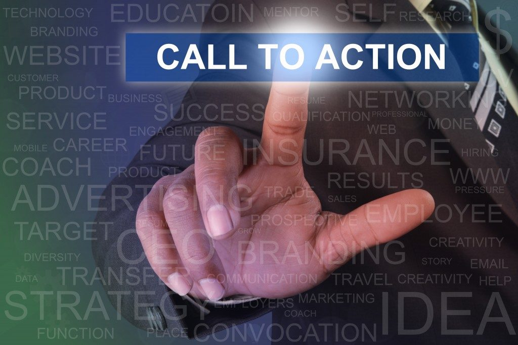 hand pointing to a call to action tab