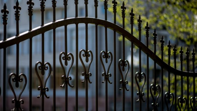 black iron fence of large building