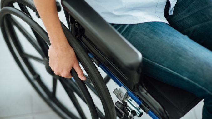 person with disability in a wheel chair