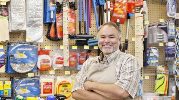 man posed in a hardware store