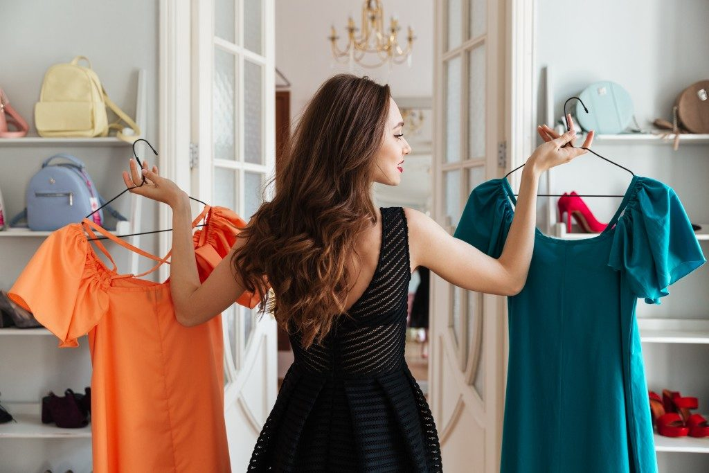 woman choosing what outfit to wear
