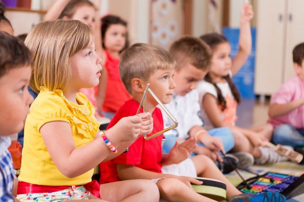 Preschool children playing music