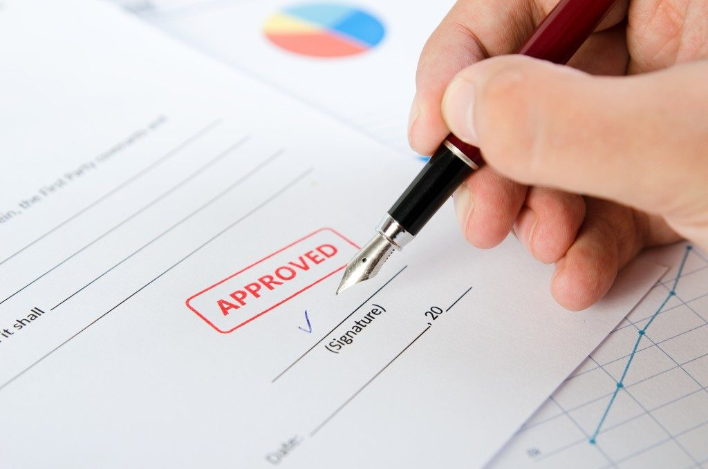 person signing an approved document