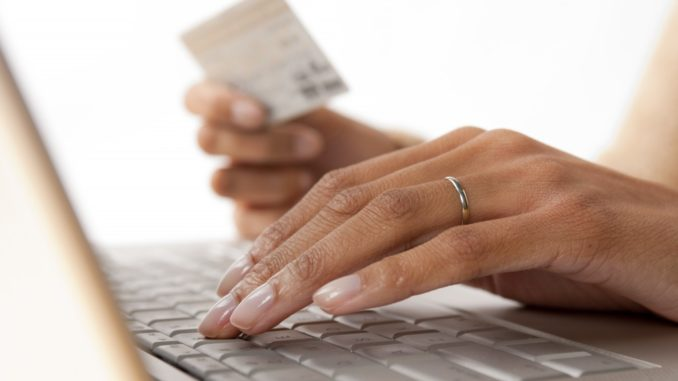 woman placing card details on the computer