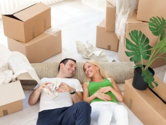 couple relaxing in the middle of cardboard boxes