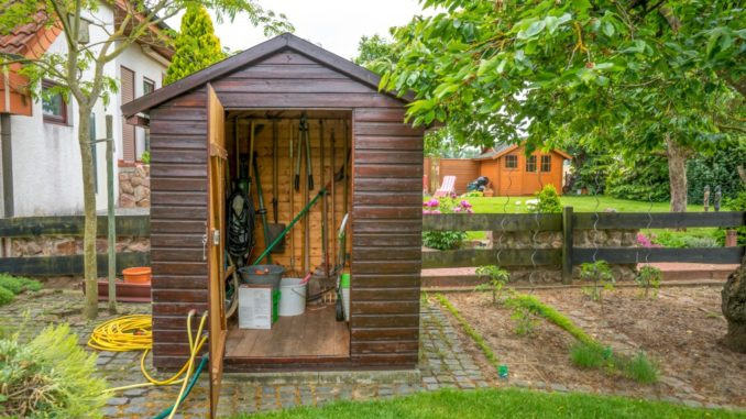 garden shed with tools and materials stored
