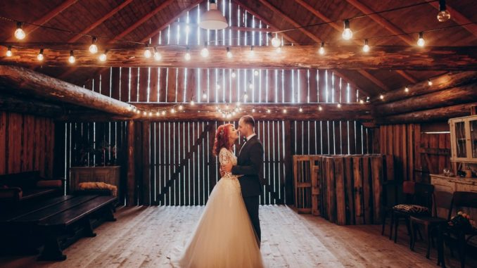groom and bride in a barn wedding