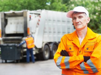 worker in yellow uniform working in waste management