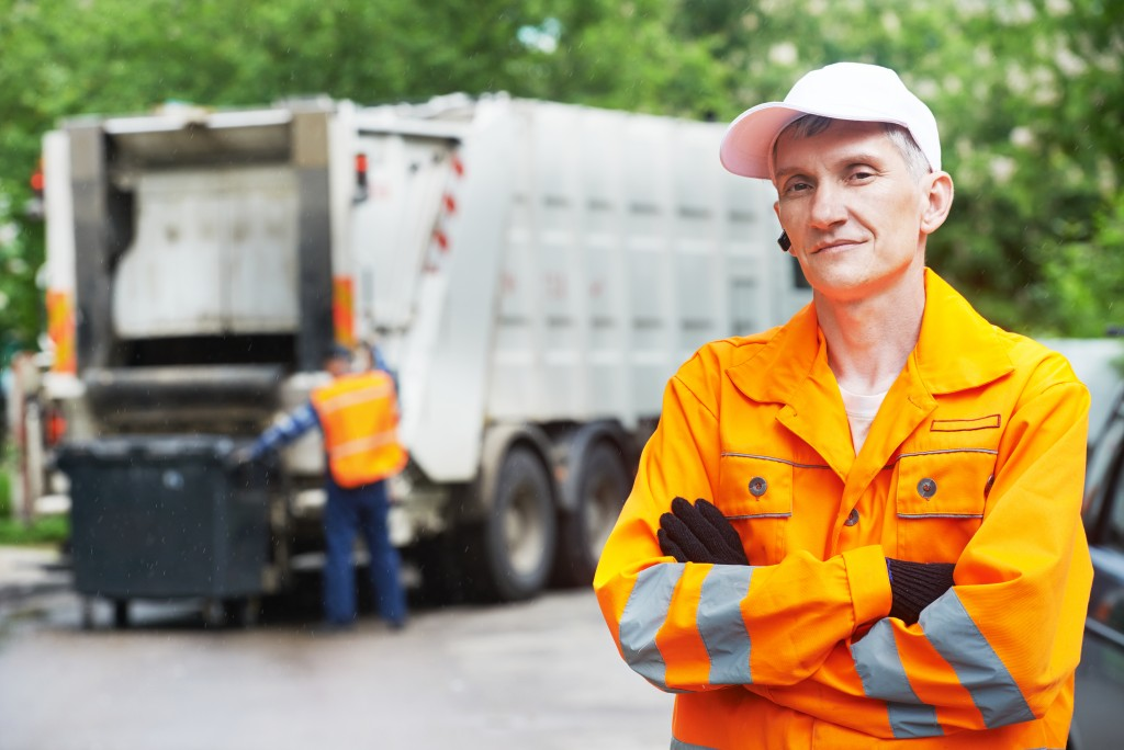worker in yellow uniform working in waste management