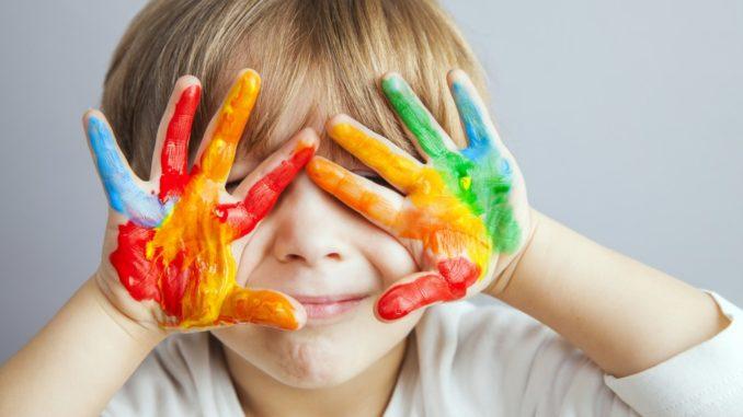 a child with fingerpaint
