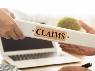 person handing over claims binder